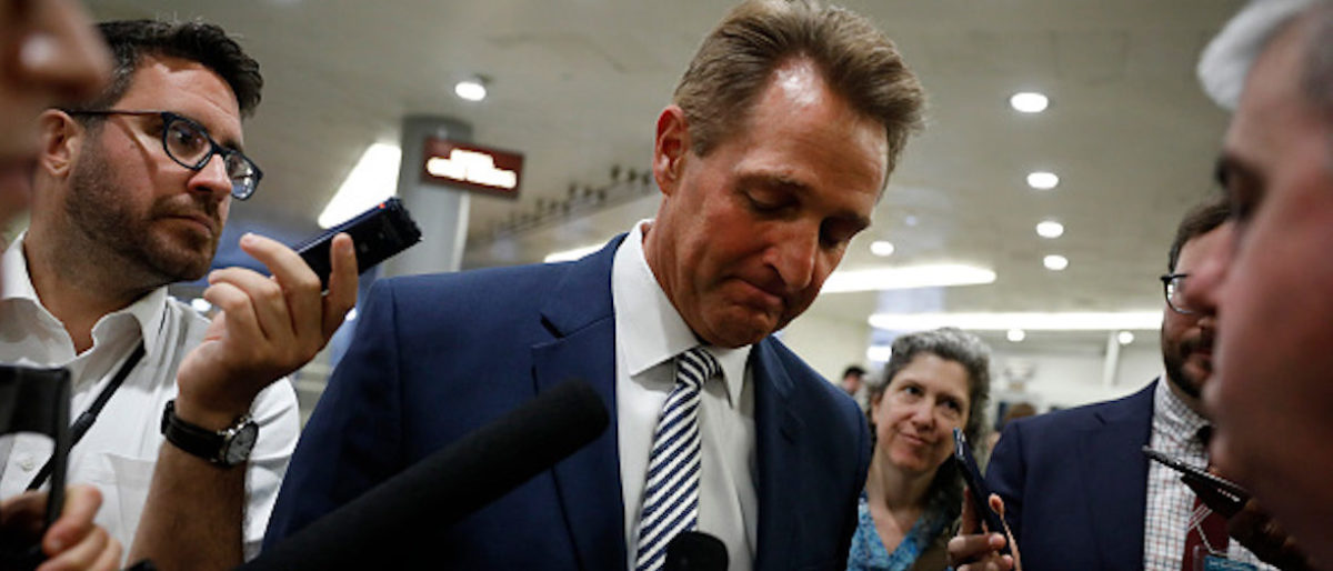 WASHINGTON, D.C. -- JUNE 26: GOP Sen. Jeff Flake of Arizona speaks with reporters ahead of the weekly policy luncheons at the U.S. Capitol June 26, 2018 in Washington, D.C. Lawmakers are reacting to President Trump's immigration policy. (Photo by Aaron P. Bernstein/Getty Images)