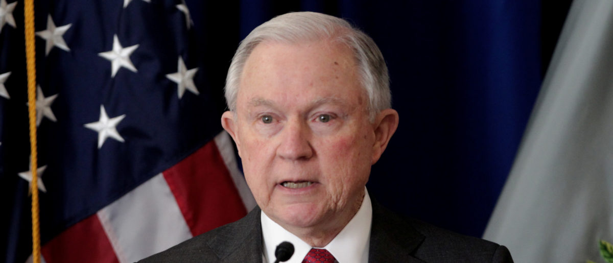 United States Attorney General Jeff Sessions addresses a crowd of law enforcement officers over new efforts to reduce violent crime and the opioid crisis at the U.S. Attorney's Office for the Western District of Kentucky in Louisville, Kentucky, January 30, 2018. REUTERS/John Sommers II