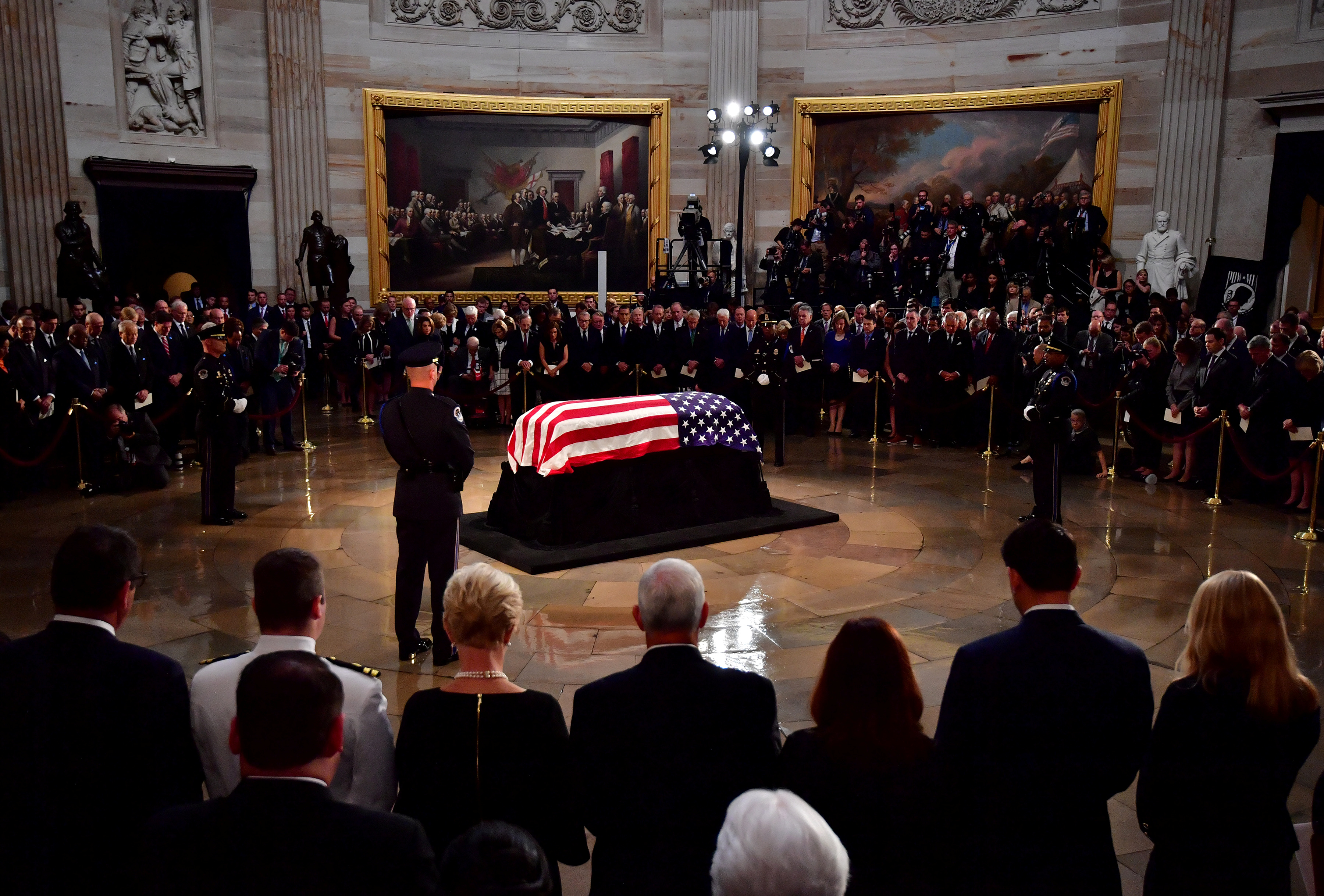 Mourners surround the casket of former Senator John McCain in the Capitol Rotunda where he will lie in state at the U.S. Capitol, in Washington, D.C. on Friday, August 31, 2018. Kevin Dietsch/POOL Via REUTERS