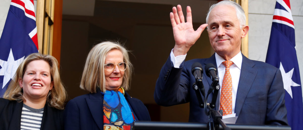 Former Australian Prime Minister Malcolm Turnbull waves next to wife Lucy and daughter Daisy after a news conference in Canberra, Australia August 24, 2018. REUTERS/David Gray