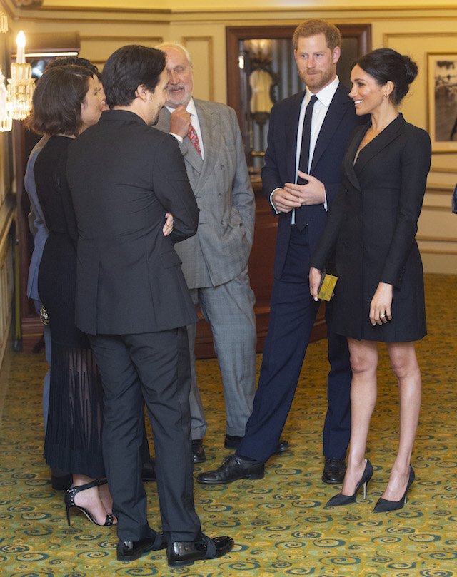 "Prince Harry, Duke of Sussex and Meghan, Duchess of Sussex speak with writer Lin Manuel Miranda and others from Sentibale as they attend a gala performance of ""Hamilton"" in support of Sentebale at Victoria Palace Theatre on August 29, 2018 in London, England. (Photo by Dan Charity - WPA Pool/Getty Images)"