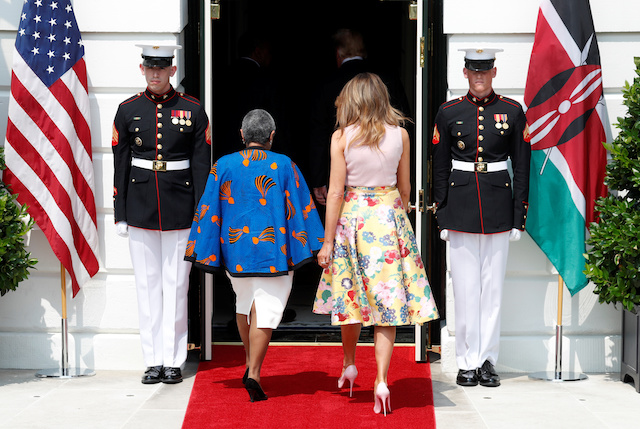 U.S. first lady Melania Trump walks with Kenya first lady Margaret Kenyatta upon the arrival of Kenyan President Uhuru Kenyatta to meet with President Donald Trump at the White House in Washington, U.S., August 27, 2018. REUTERS/Kevin Lamarque