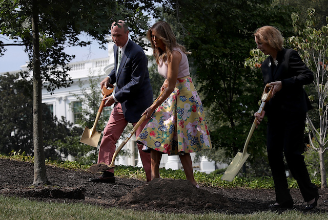 U.S. first lady Melania Trump (C) takes part in a tree planting ceremony on the south grounds of the White House August 27, 2018 in Washington, DC. The tree comes from the original Eisenhower Oak located near the Kennedy Garden that was excavated from the grounds earlier this year. Joining the first lady is Mary Jean Eisenhower (R), granddaughter of President Dwight Eisenhower and Richard Gatchell Jr. (L), fifth generation grandson of President James Monroe. (Photo by Win McNamee/Getty Images)