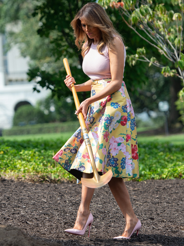 US First Lady Melania Trump participates in a tree planting ceremony of a sapling from the original Eisenhower Oak tree that was removed from the grounds last year, on the South Lawn of the White House in Washington, DC on August 27, 2018, (Photo credit: SAUL LOEB/AFP/Getty Images)