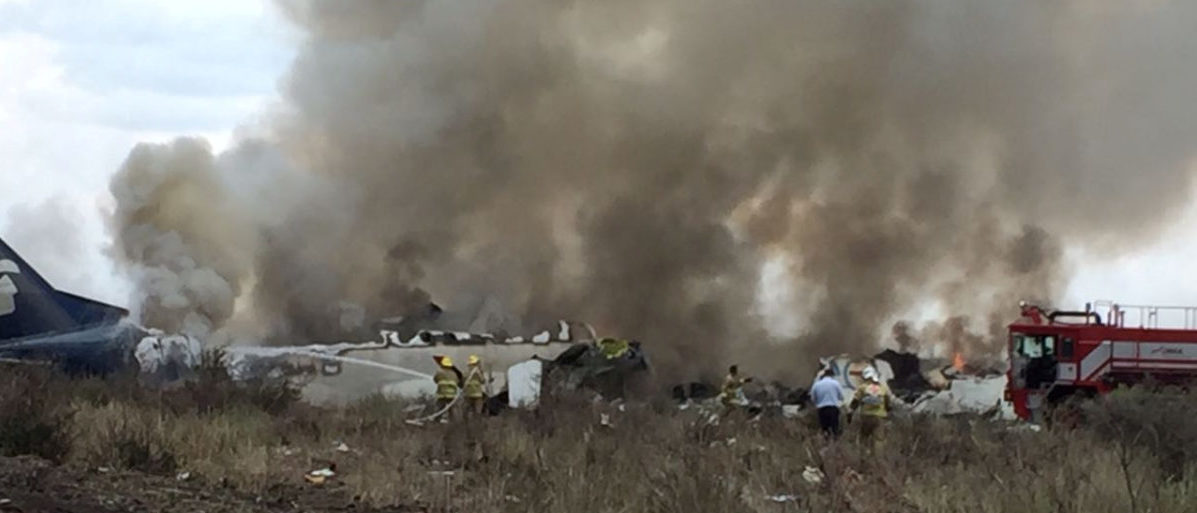 Rescue personnel work at the site where an Aeromexico-operated Embraer passenger jet crashed in Mexico's northern state of Durango, July 31, 2018, in this picture obtained from social media. Proteccion Civil Durango/via REUTERS