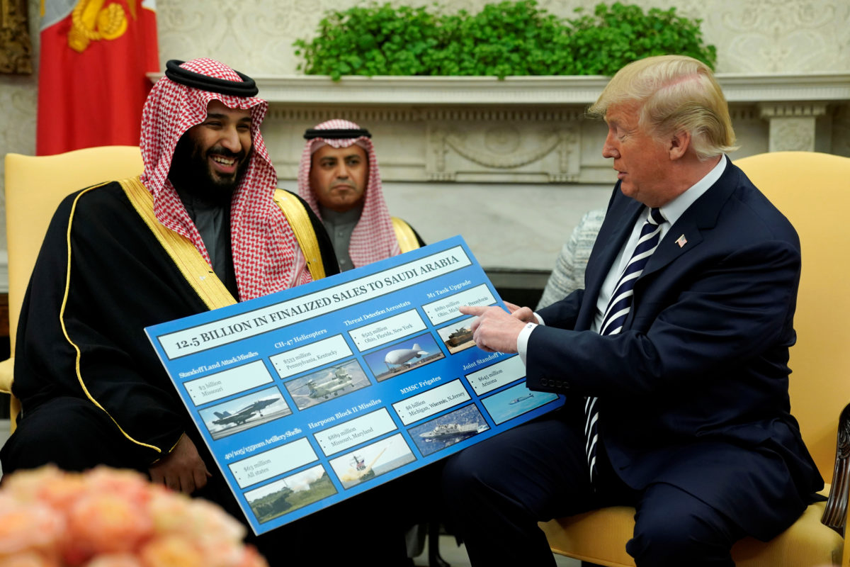 U.S. President Donald Trump holds a chart of military hardware sales as he welcomes Saudi Arabia's Crown Prince Mohammed bin Salman in the Oval Office at the White House in Washington, March 20, 2018. REUTERS/Jonathan Ernst