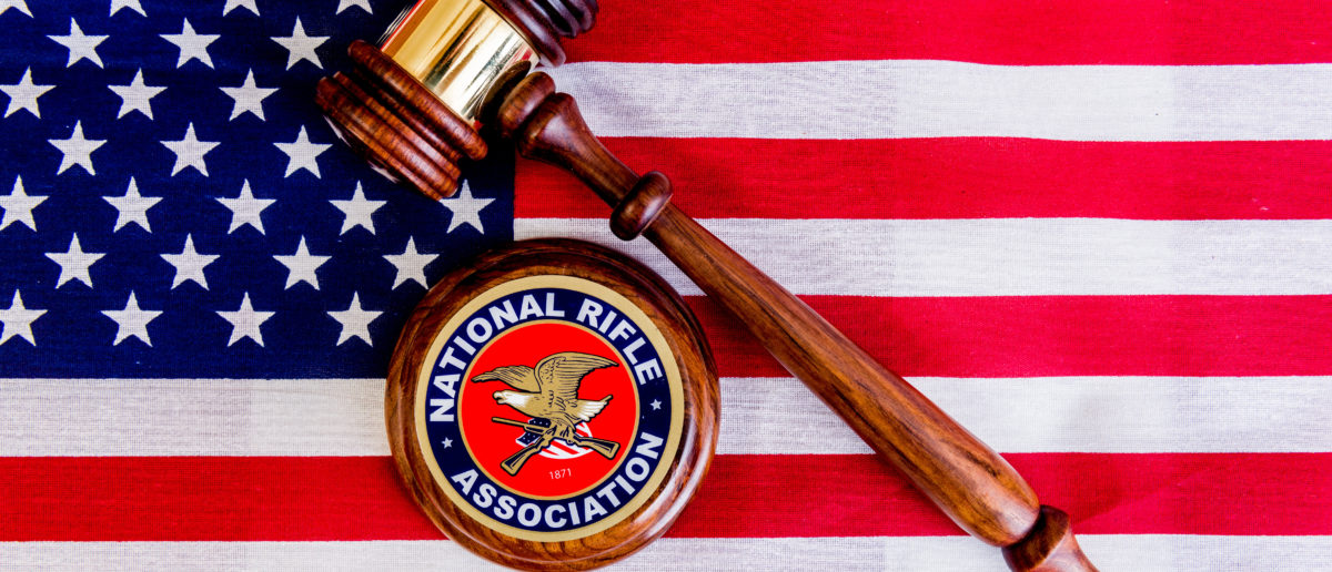 Winneconne - 11 May 2018: A NRA sticker with a judges gavel on an American flag [Shutterstock/Keith Homan]