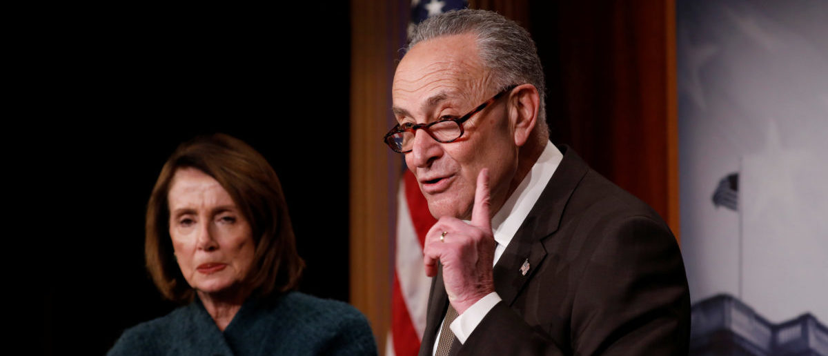 Senate Minority Leader Chuck Schumer, accompanied by House Minority Leader Nancy Pelosi, speaks at a news conference about the omnibus spending bill moving through Congress on Capitol Hill in Washington, U.S., March 22, 2018. REUTERS/Aaron P. Bernstein