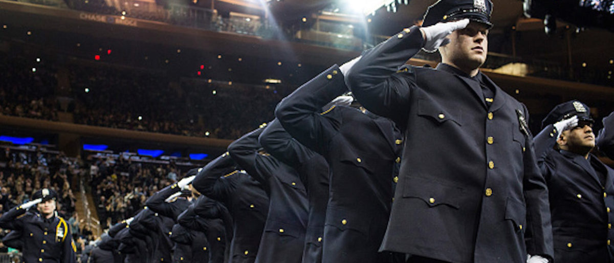 NEW YORK, NY - DECEMBER 29: New police recruits salute during the New York Police Department (NYPD) graduation ceremony on December 29, 2015 at Madison Square Garden in New York City. More than 1,000 new graduates joined the police force. (Photo by Andrew Burton/Getty Images)