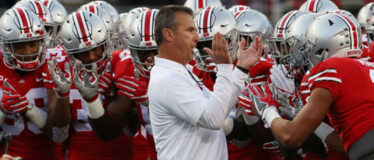 COLUMBUS, OH - SEPTEMBER 09: Head coach Urban Meyer of the Ohio State Buckeyes stands with his players before the game against the Oklahoma Sooners at Ohio Stadium on September 9, 2017 in Columbus, Ohio. (Photo by Gregory Shamus/Getty Images)