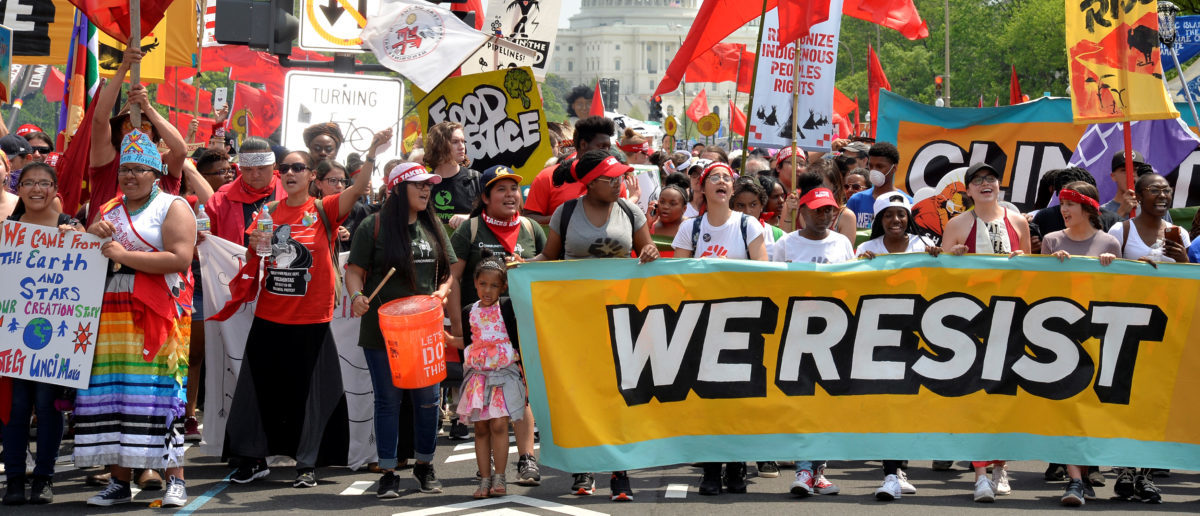 Demonstrators march down Pennsylvania Avenue during a People's Climate March, to protest U.S. President Donald Trump's stance on the environment, in Washington, U.S., April 29, 2017. REUTERS/Mike Theiler