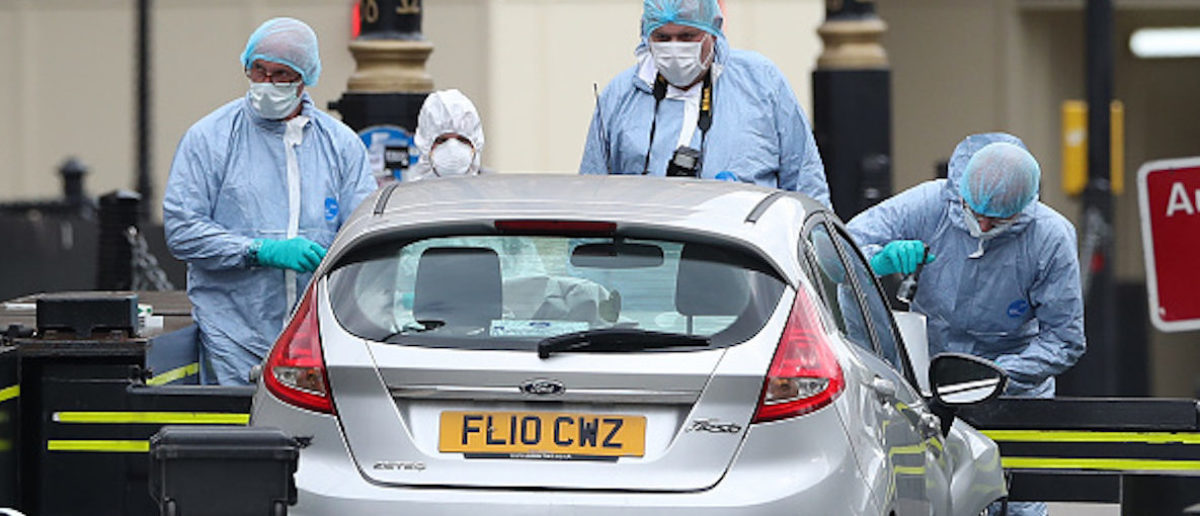 "Police forensics officers work around a silver Ford Fiesta car that was driven into a barrier at the Houses of Parliament in central London on August 14, 2018. - A car crashed into barriers outside Britain's Houses of Parliament in a suspected terror attack on Tuesday, injuring a ""number of pedestrians"" yards from where five people were killed last year. Police said they had arrested the driver, in his 20s, and were holding him on suspicion of terrorist offences. (Photo by Daniel LEAL-OLIVAS / AFP) (Photo credit should read DANIEL LEAL-OLIVAS/AFP/Getty Images)"
