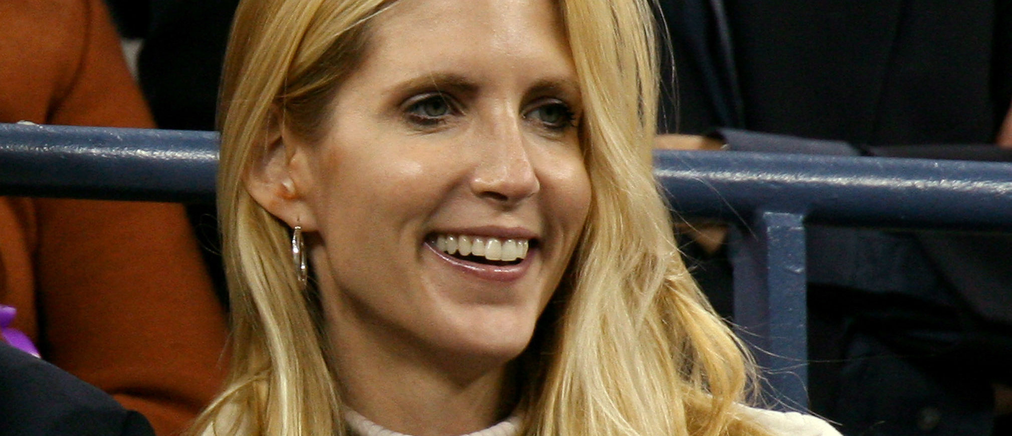 Conservative commentator Ann Coulter watches play at the U.S. Open tennis tournament in New York September 4, 2006. REUTERS/Jeff Zelevansky (UNITED STATES) - GM1DTKUGGQAA