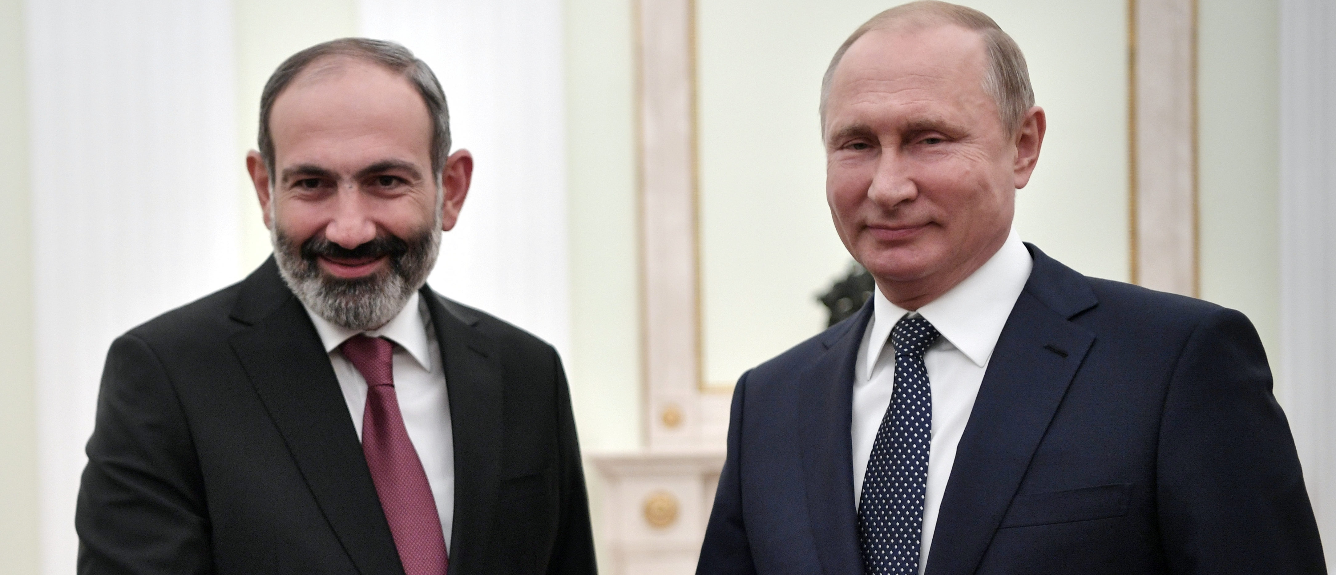 Russian President Vladimir Putin (R) meets with Armenian Prime Minister Nikol Pashinyan at the Kremlin in Moscow, Russia June 13, 2018. Sputnik/Alexei Nikolsky/Kremlin via REUTERS ATTENTION EDITORS - THIS IMAGE WAS PROVIDED BY A THIRD PARTY. - RC1710C03C10