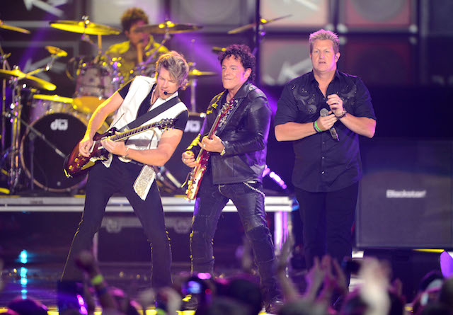 Joe Don Rooney and Jay DeMarcus of Rascal Flatts perform with Arnel Pineda of Journey onstage at the 2012 CMT Music awards at the Bridgestone Arena on June 6, 2012 in Nashville, Tennessee. (Photo by Jason Merritt/Getty Images)
