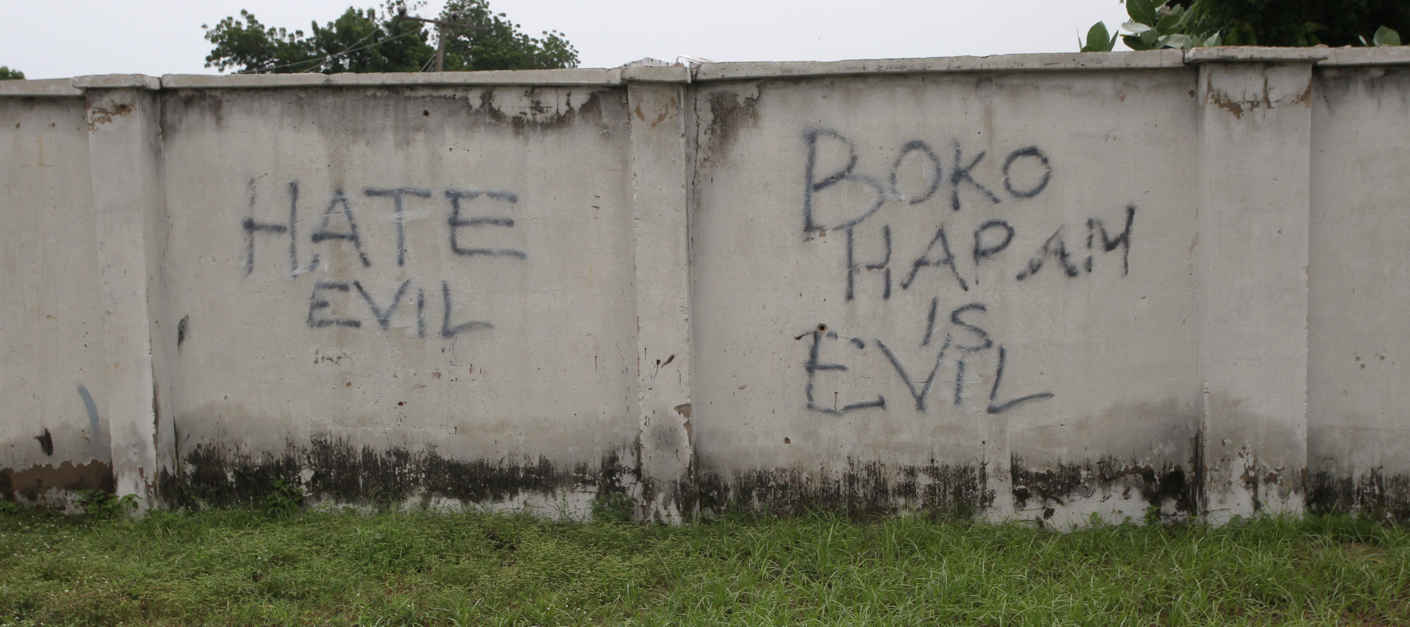 FILE PHOTO: Writings describing Boko Haram are seen on the wall along a street in Bama, in Borno, Nigeria August 31, 2016. Picture taken August 31, 2016. REUTERS/Afolabi Sotunde/File Photo - RC1BC1D7C110