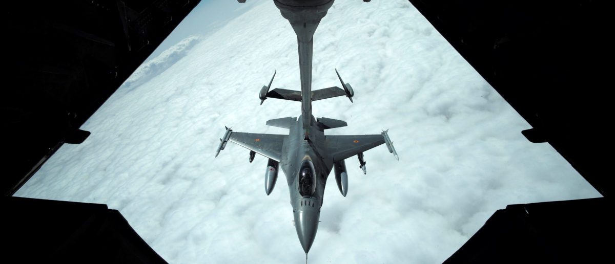 A US Air Force F-16 receives fuel from a fuel boom suspended from a US Air Force KC-10 Extender during mid-air refueling support to Operation Inherent Resolve over Iraq and Syria air space, March 15, 2017. REUTERS/Hamad I Mohammed - RC14E283A790