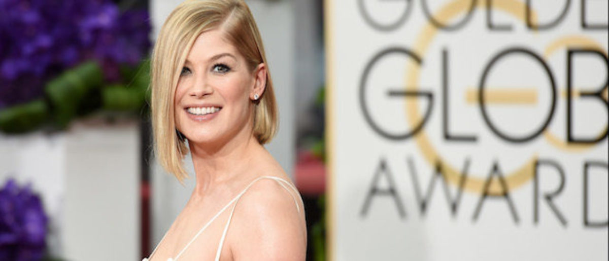Actress Rosamund Pike attends the 72nd Annual Golden Globe Awards at The Beverly Hilton Hotel on January 11, 2015 in Beverly Hills, California. (Photo by Jason Merritt/Getty Images)