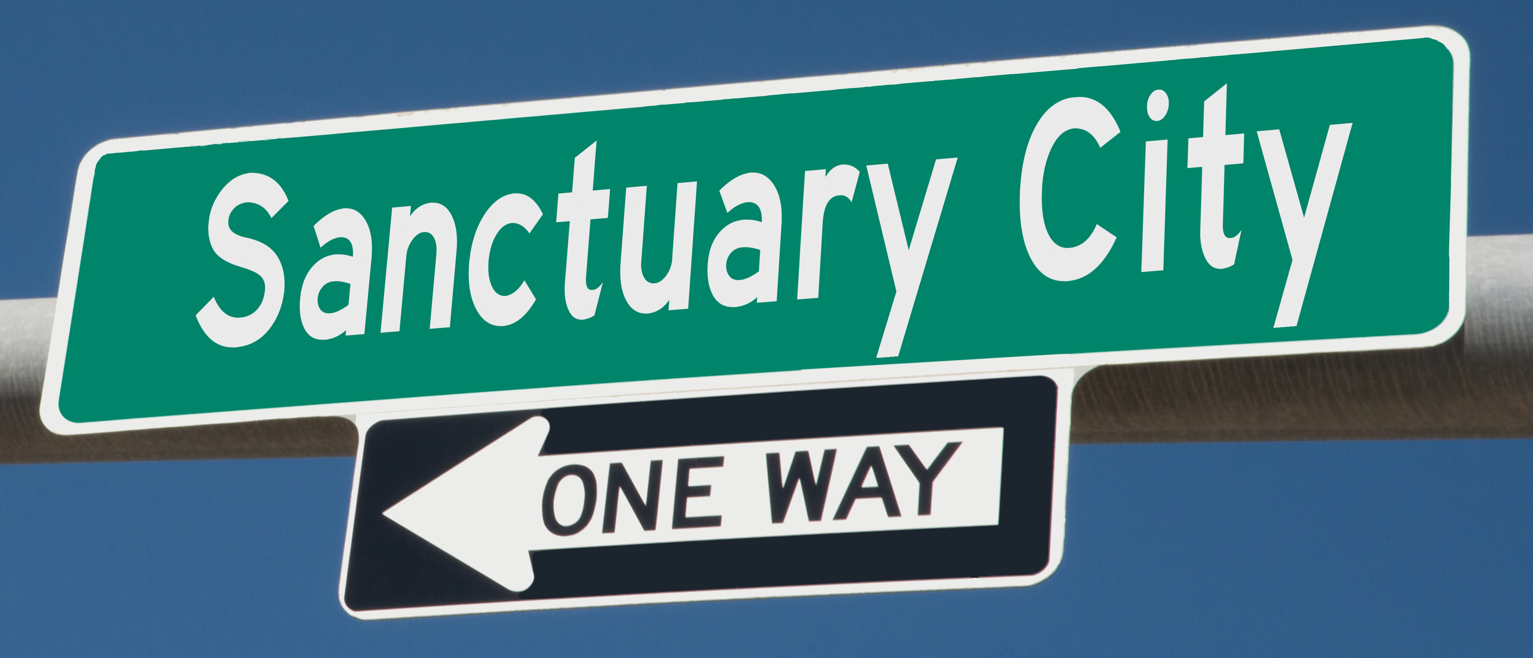 Sanctuary City sign (Shutterstock/Rex Wholster)