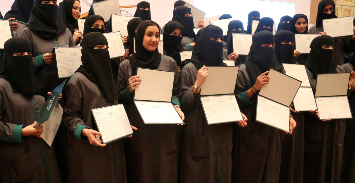 Saudi women hold their diplomas during the graduation ceremony of Saudi women car-accident inspectors, a few days before women are set to take the wheel in Riyadh, Saudi Arabia June 21, 2018. Picture taken June 21, 2018. REUTERS/Noemie Olive