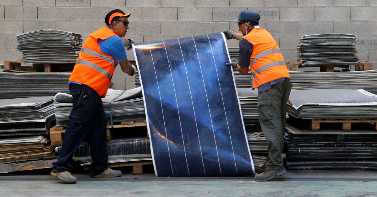 Employees work at Veolia's solar panel recycling plant in Rousset