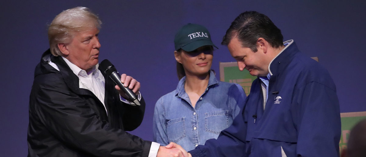 PEARLAND, TEXAS - SEPTEMBER 02: U.S. President Donald Trump, with first lady Melania Trump, greets Sen. Ted Cruz (R) (R-TX) while visiting a volunteer center packing emergency supplies for residents impacted by Hurricane Harvey at the First Church of Pearland September 2, 2017 in Pearland, Texas. Pearland, just south of Houston, was heavily damaged by the floodwaters created by the hurricane. (Photo by Win McNamee/Getty Images)