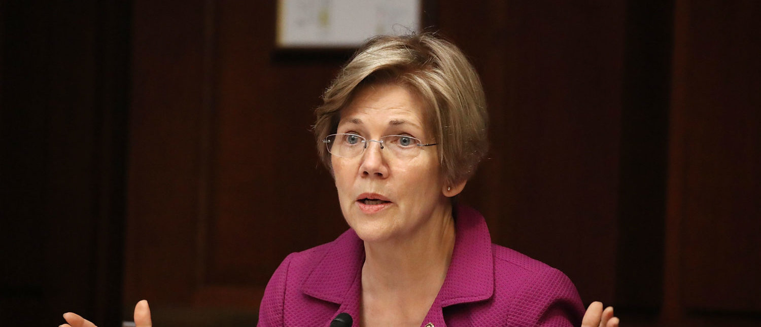 """WASHINGTON, D.C. - JULY 19: Sen. Elizabeth Warren (D-MA) speaks during the Democratic Policy and Communications Committee hearing in the Capitol building on July 19, 2017 in Washington, DC. The hearing dealt with the subject of """"Democracy for Sale"""" and how they feel that the campaign finance system allows foreign governments to buy Influence in the U.S. Elections and what can be done about it. (Photo by Joe Raedle/Getty Images)"""