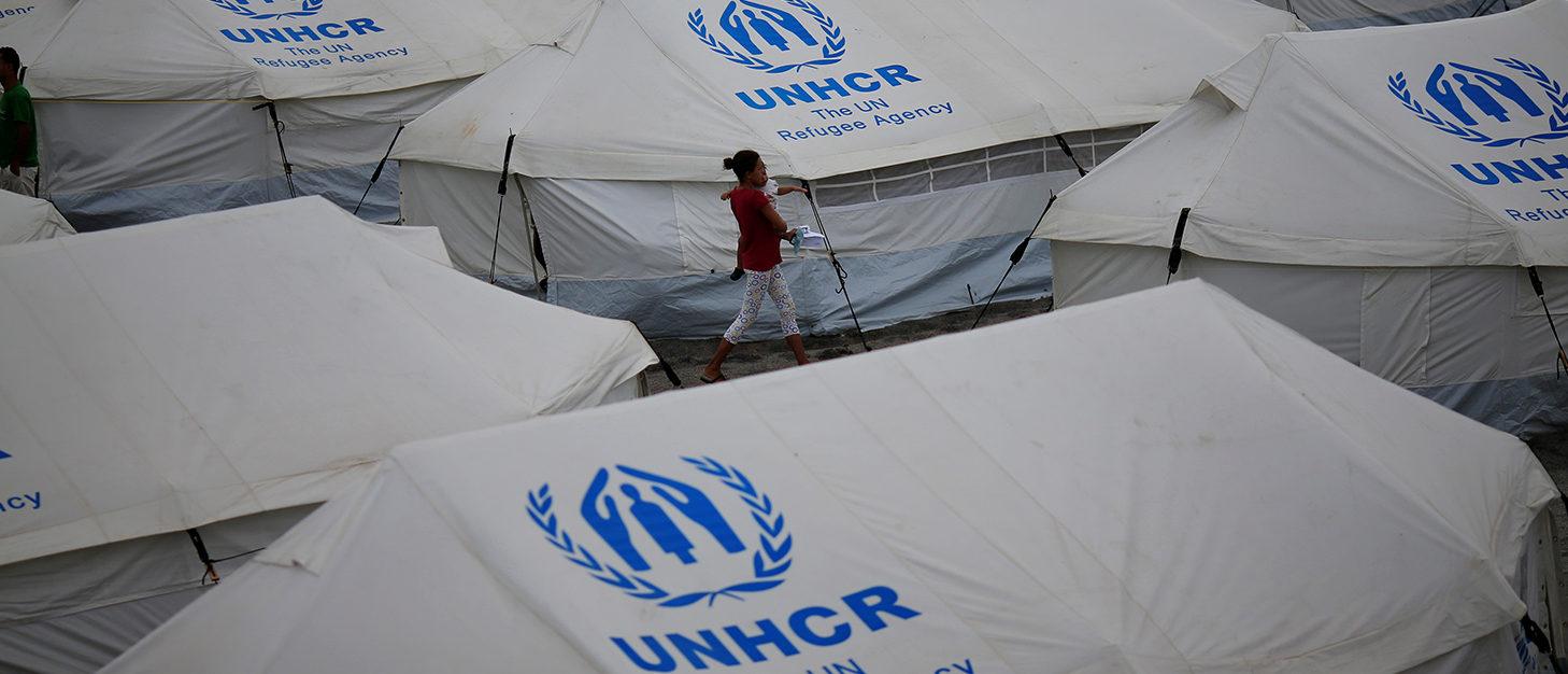 Venezuelan migrants walk between the tents in UNHCR shelter in Boa Vista, Brazil May 3, 2018. Picture taken May 3, 2018. REUTERS/Ueslei Marcelino