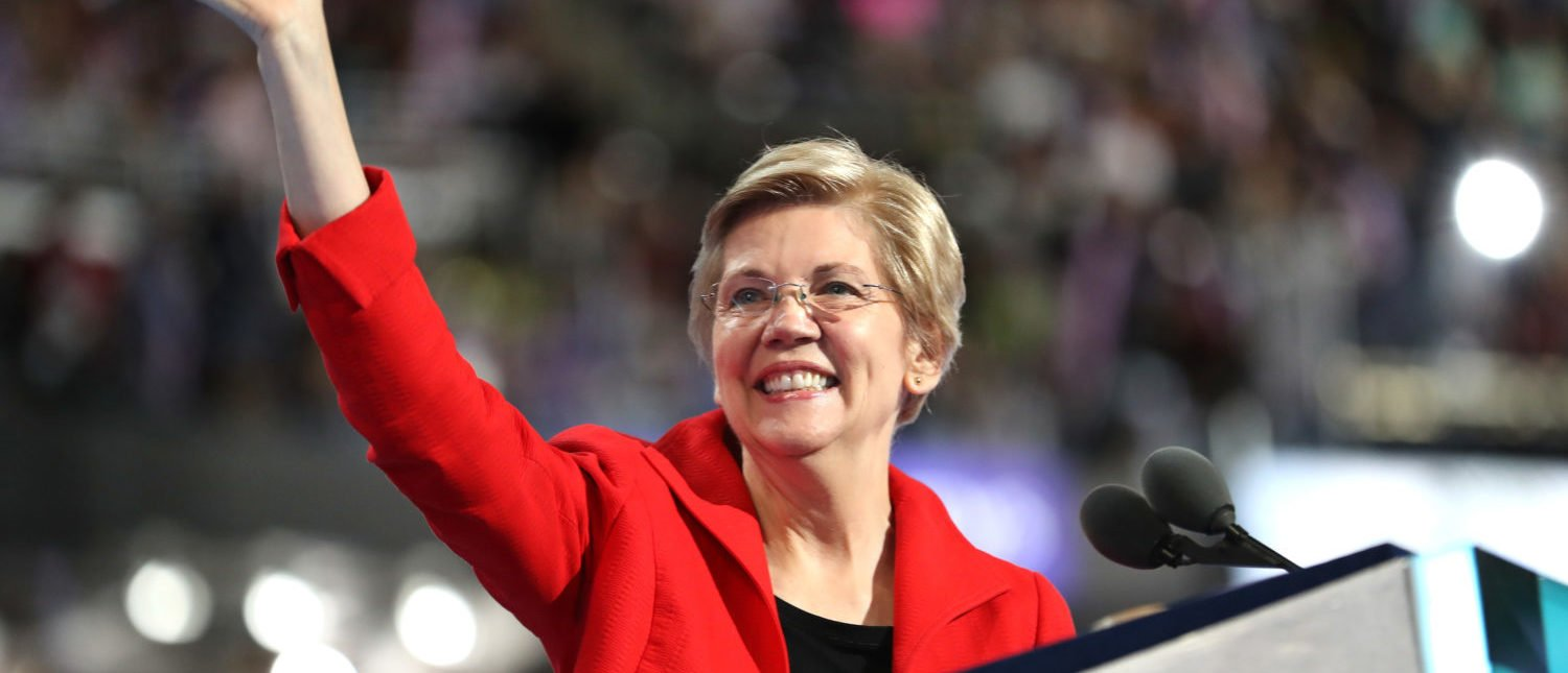 PHILADELPHIA, PA - JULY 25: Sen. Elizabeth Warren (D-MA) acknowledges the crowd as she walks on stage to deliver remarks on the first day of the Democratic National Convention at the Wells Fargo Center, July 25, 2016 in Philadelphia, Pennsylvania. An estimated 50,000 people are expected in Philadelphia, including hundreds of protesters and members of the media. The four-day Democratic National Convention kicked off July 25. (Photo by Joe Raedle/Getty Images)