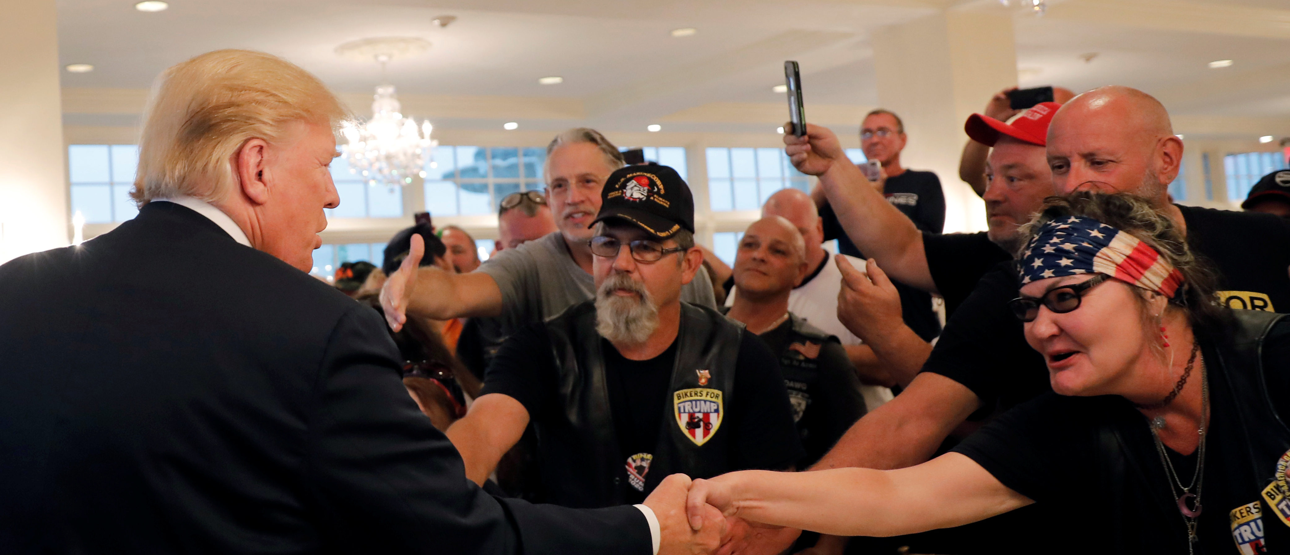 """U.S. President Donald Trump meets with supporters from a group called """"Bikers for Trump"""" at the Trump National Golf Club in Bedminster, New Jersey, U.S., August 11, 2018. REUTERS/Carlos Barria"""