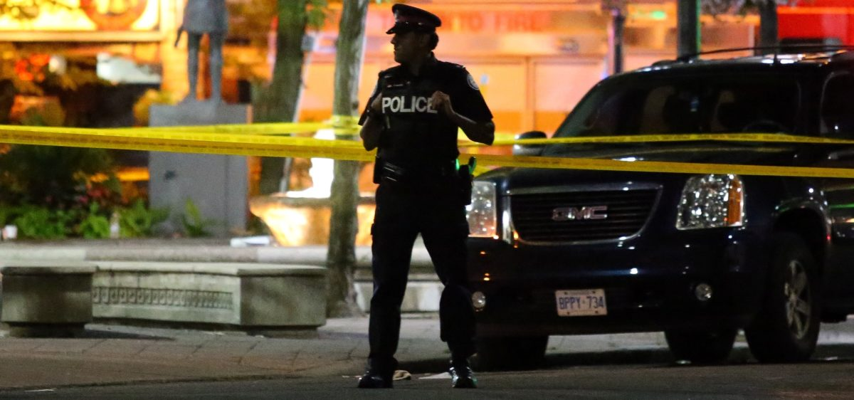 A police officer guards the scene of a mass shooting in Toronto, Canada, July 22, 2018. Picture taken July 22, 2018. REUTERS/Chris Helgren
