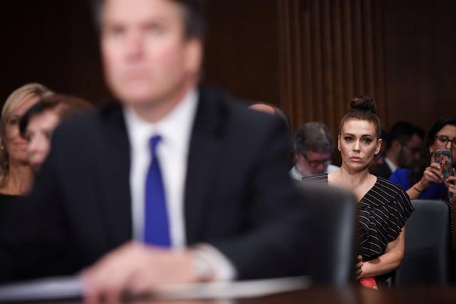 Actress Alyssa Milano listens as Supreme Court nominee Judge Brett Kavanaugh testifies before the US Senate Judiciary Committee on Capitol Hill in Washington, DC, U.S., September 27, 2018.Saul Loeb/Pool via REUTERS