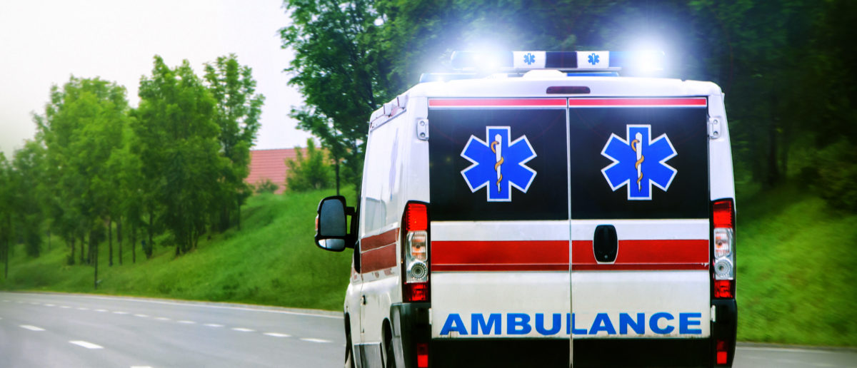 Pictured is an ambulance headed to hospital. (Shutterstock/OgnjenO)