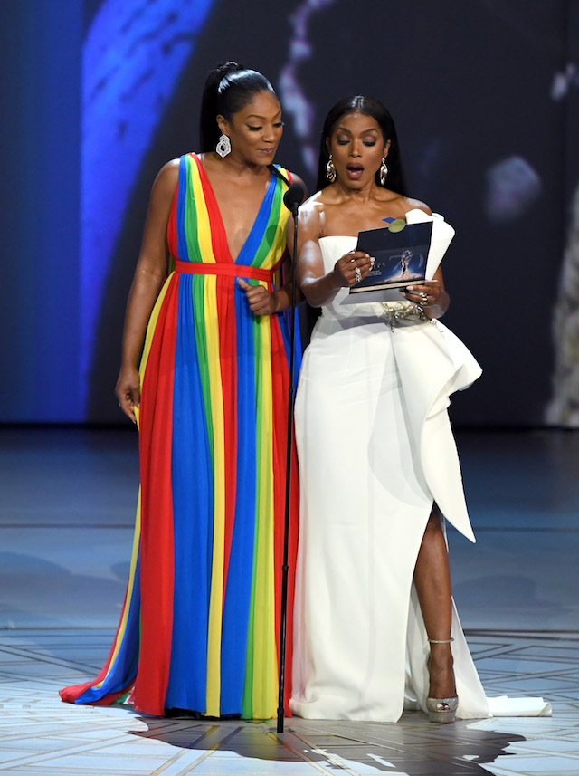 Tiffany Haddish (L) and Angela Bassett speak onstage during the 70th Emmy Awards at Microsoft Theater on September 17, 2018 in Los Angeles, California. (Photo by Kevin Winter/Getty Images)