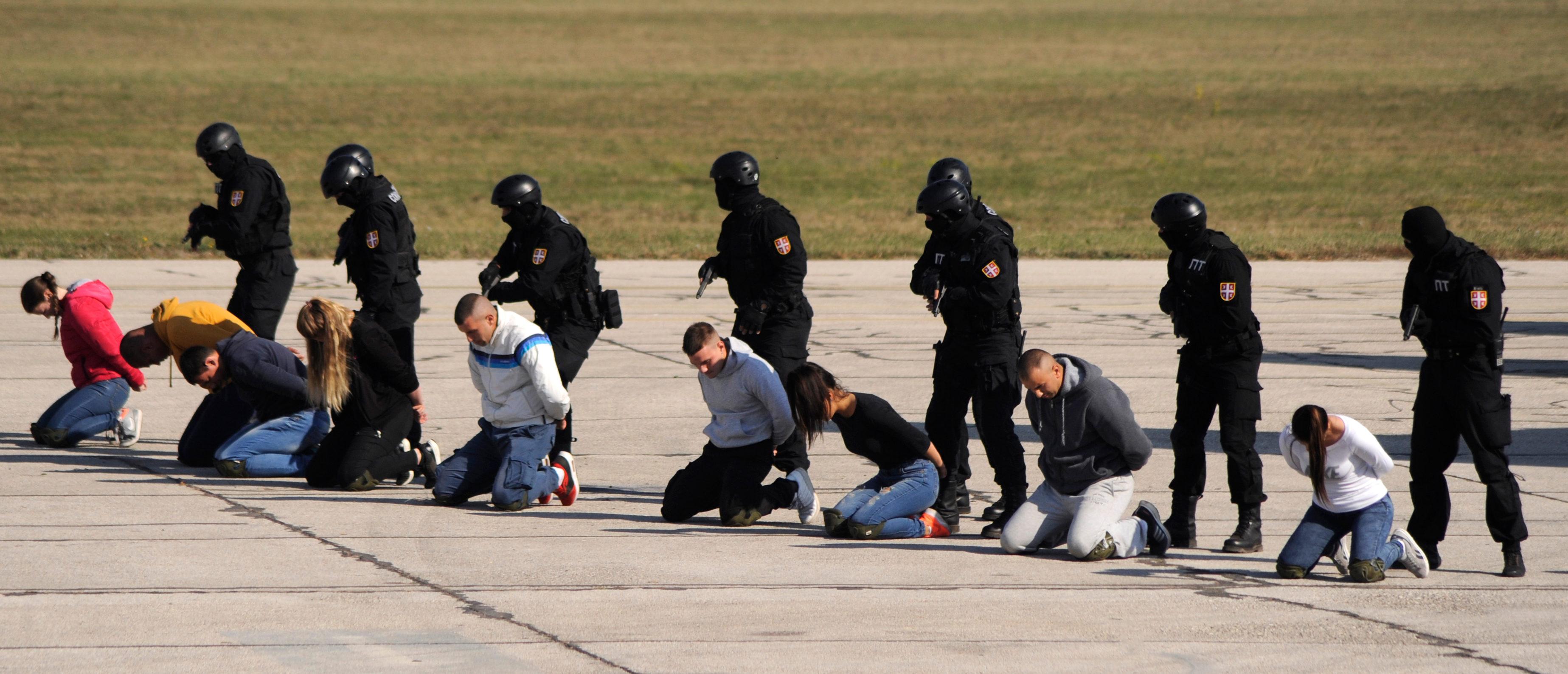 Arrested Suspects (Shutterstock/bibiphoto)