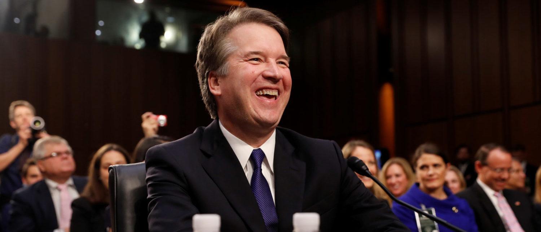 U.S. Supreme Court nominee Judge Brett Kavanaugh laughs at the start of his U.S. Senate Judiciary Committee confirmation hearing on Capitol Hill in Washington, U.S., September 4, 2018. REUTERS/Joshua Roberts