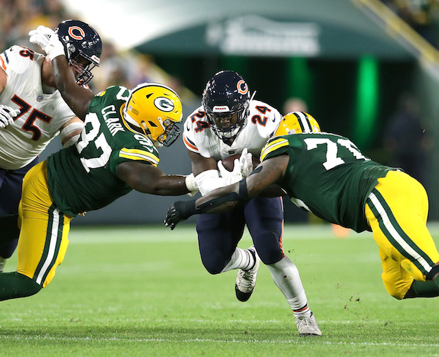 Jordan Howard #24 of the Chicago Bears runs between Kenny Clark #97 of the Green Bay Packers and Mike Daniels #76 during the first quarter of a game at Lambeau Field on September 9, 2018 in Green Bay, Wisconsin. (Photo by Dylan Buell/Getty Images)