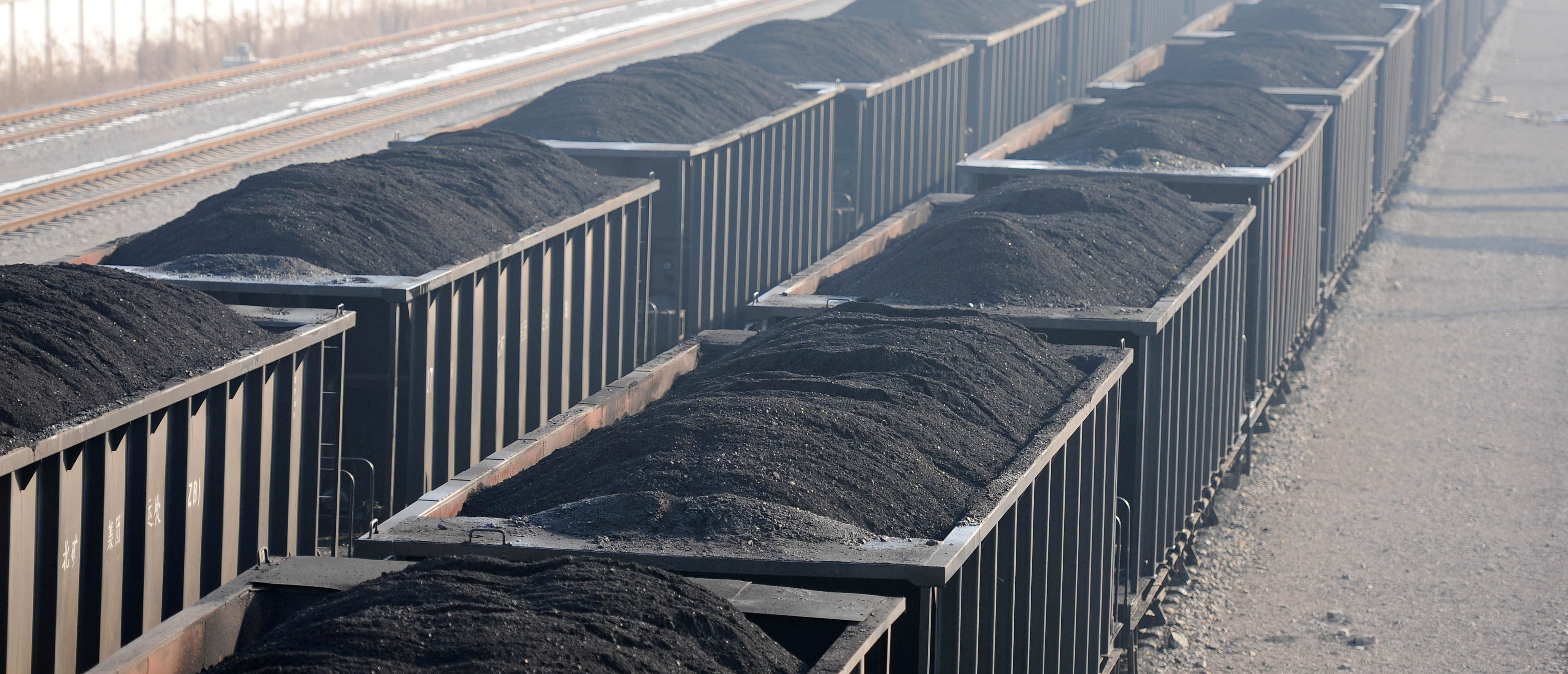 Carriages loaded with coal are seen at a mine pit of Huaibei Mining Group in Huaibei, Anhui province, China January 11, 2018. Picture taken January 11, 2018. China Daily via REUTERS ATTENTION EDITORS - THIS IMAGE WAS PROVIDED BY A THIRD PARTY. CHINA OUT.