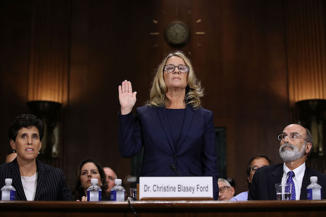Christine Blasey Ford is sworn in before testifying the Senate Judiciary Committee in the Dirksen Senate Office Building on Capitol Hill September 27, 2018 in Washington, DC. A professor at Palo Alto University and a research psychologist at the Stanford University School of Medicine, Ford has accused Supreme Court nominee Judge Brett Kavanaugh of sexually assaulting her during a party in 1982 when they were high school students in suburban Maryland. (Photo by Win McNamee/Getty Images)