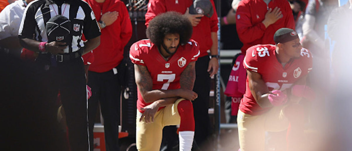 SANTA CLARA, CA - OCTOBER 23: Colin Kaepernick #7 of the San Francisco 49ers kneels for the National Anthem before their game against the Tampa Bay Buccaneers at Levi's Stadium on October 23, 2016 in Santa Clara, California. (Photo by Ezra Shaw/Getty Images)