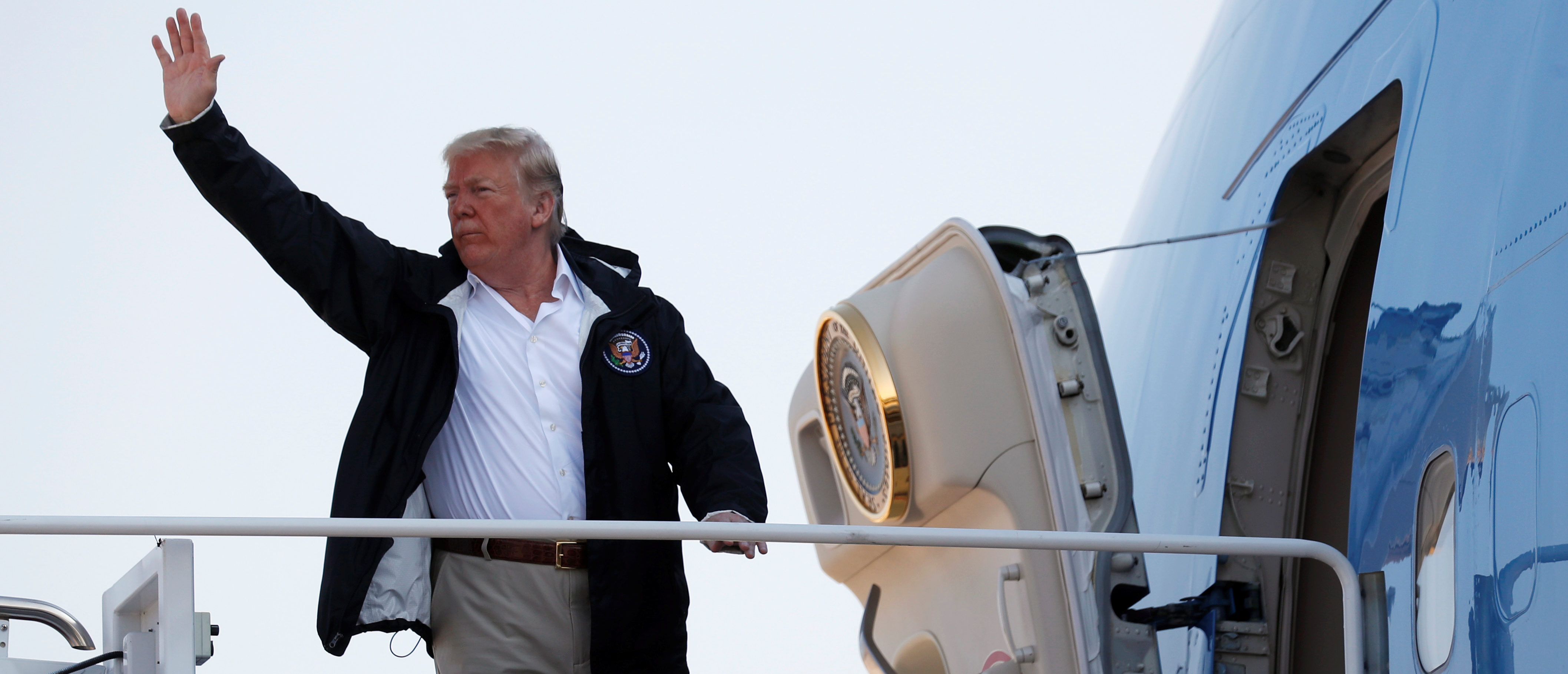 U.S. President Donald Trump boards Air Force One as he departs Joint Base Andrews in Maryland, U.S., on his way to visit areas affected by Hurricane Florence in North and South Carolina September 19, 2018. REUTERS/Kevin Lamarque