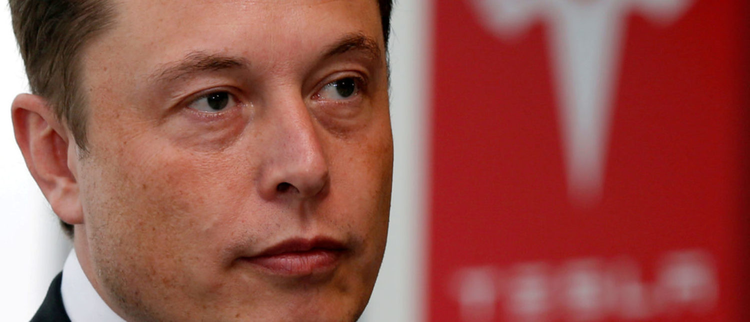 Tesla Motors Inc Chief Executive Elon Musk pauses during a news conference in Tokyo September 8, 2014. REUTERS/Toru HanaI/File Photo