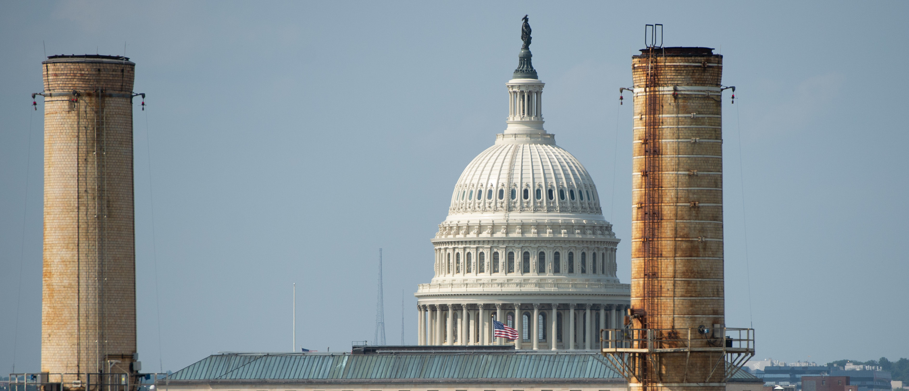 The chimney stacks of the Capitol Power Plant, a natural gas and coal burning power plant that provides steam and chilled water for heating and cooling of the US Capitol and surrounding buildings, is seen near the US Capitol in Washington, DC, August 22, 2018. - US President Donald Trump's administration announced a plan on August 21, 2018, to weaken regulations on US coal plants. The Environmental Protection Agency's new Affordable Clean Energy (ACE) rule would allow states the flexibility to set their own standards for performance at existing coal-fired power plants, rather than follow a single federal standard. (Photo by SAUL LOEB / AFP) (Photo credit should read SAUL LOEB/AFP/Getty Images)