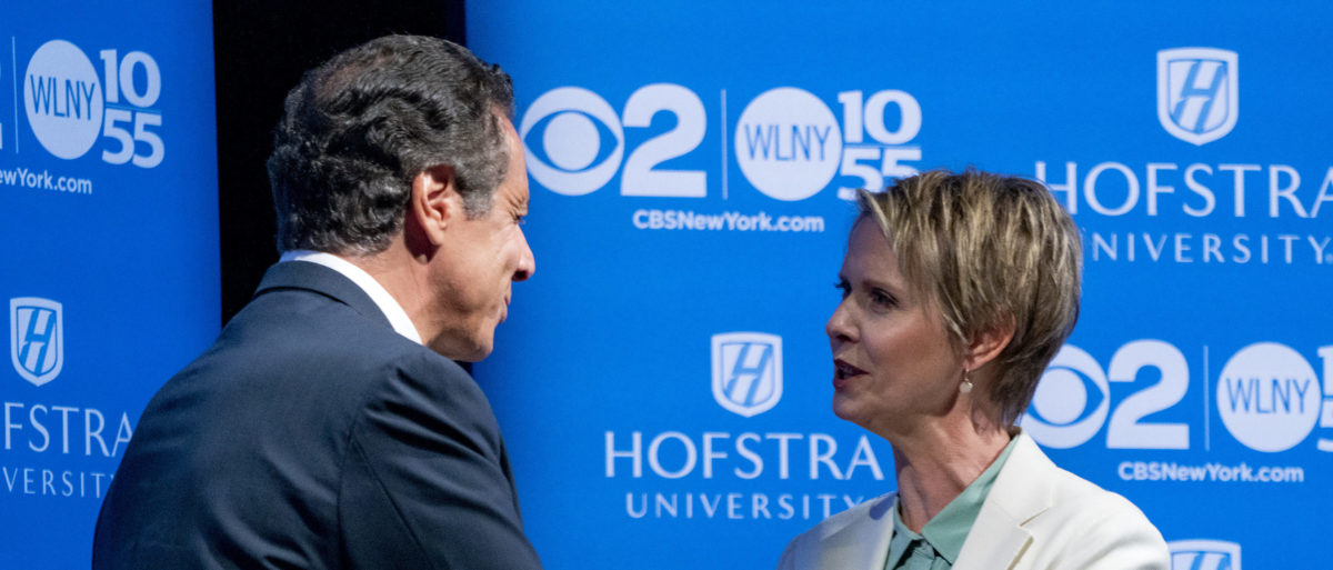 New York Gov. Andrew Cuomo and primary opponent Cynthia Nixon shake hands before a debate at Hofstra University August 29, 2018 in Hempstead, New York. Photo by Craig Ruttle-Pool/Getty Images