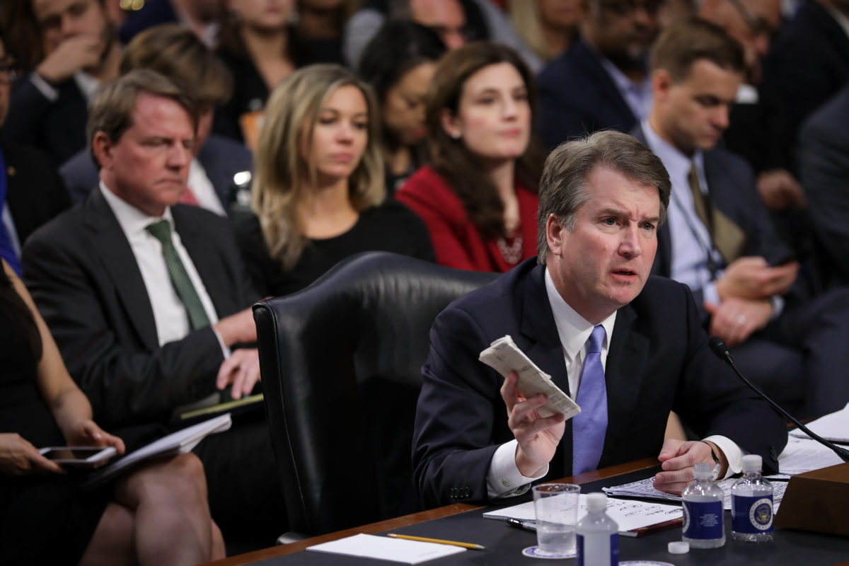 WASHINGTON, DC - SEPTEMBER 6: Supreme Court nominee Judge Brett Kavanaugh holds a copy of the Constitution as he testifies before the Senate Judiciary Committee on the third day of his Supreme Court confirmation hearing on Capitol Hill September 6, 2018 in Washington, DC. Kavanaugh was nominated by President Donald Trump to fill the vacancy on the court left by retiring Associate Justice Anthony Kennedy. (Photo by Drew Angerer/Getty Images)