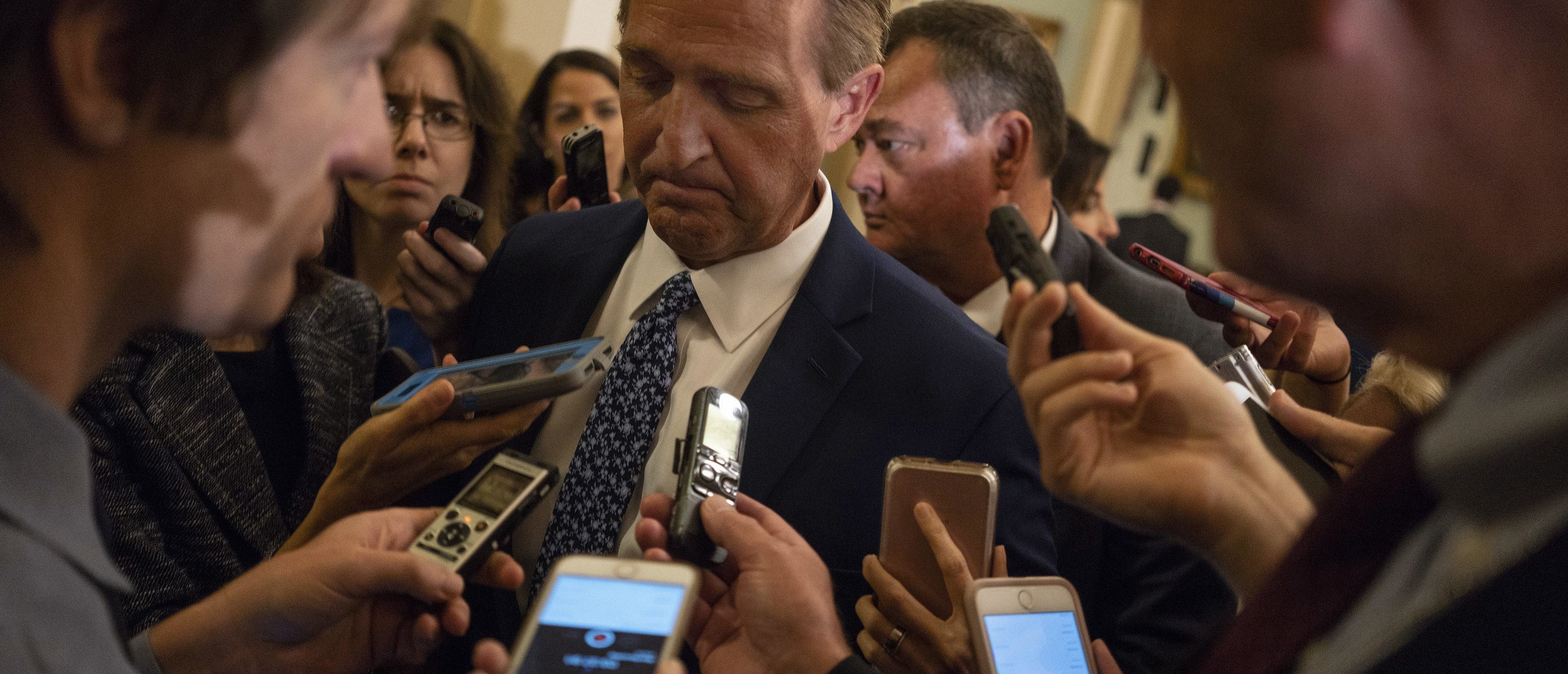 WASHINGTON, DC - SEPTEMBER 18: Sen. Jeff Flake (R-AZ) speaks with reporters ahead of the weekly policy luncheons on Capitol Hill September 18, 2018 in Washington, DC. Senate Majority Leader Mitch McConnell has announced a hearing before the Judiciary Committee with Kavanaugh and his accuser, Christine Blasey Ford, next Monday. (Photo by Aaron P. Bernstein/Getty Images)