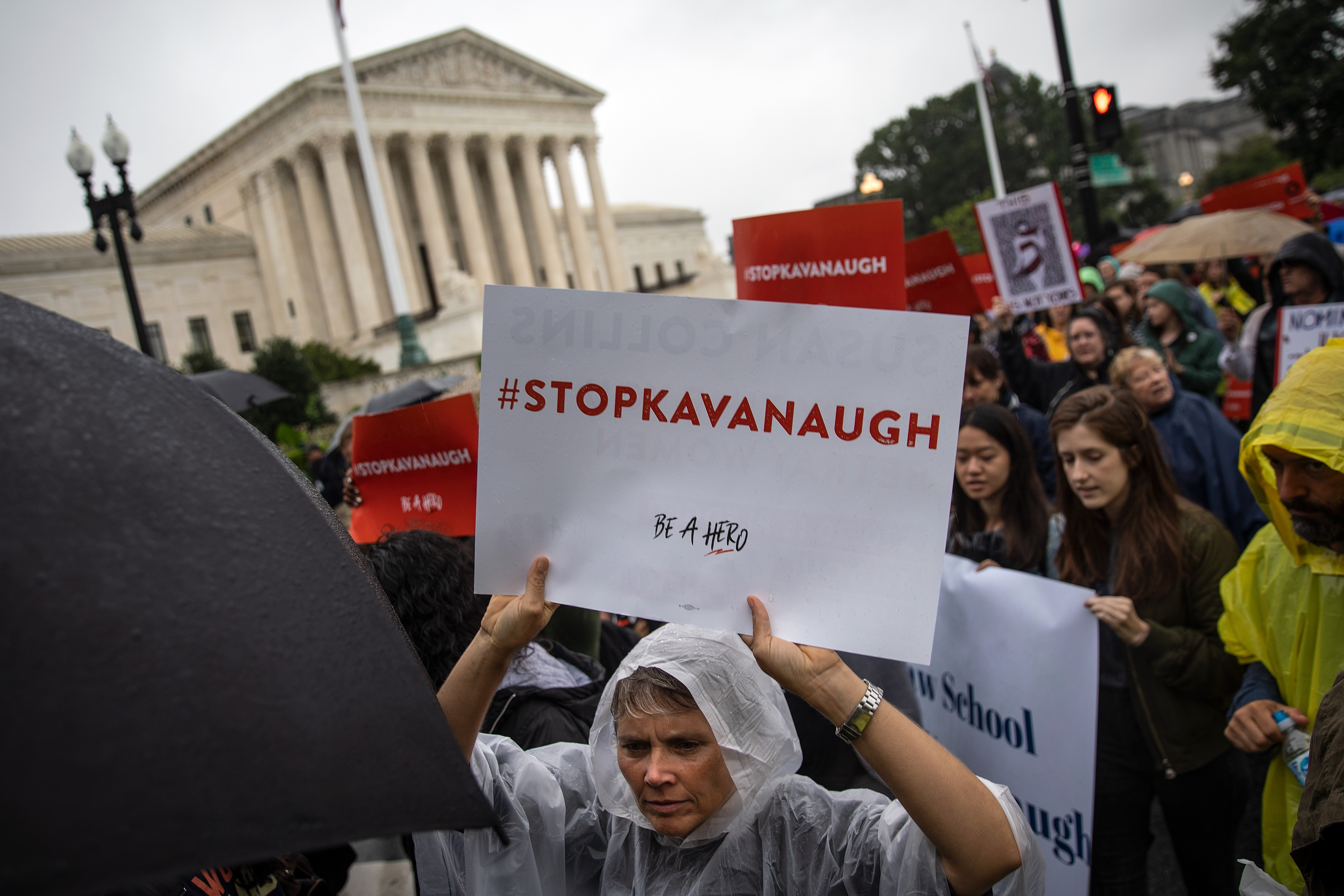 WASHINGTON, DC - SEPTEMBER 24: Protestors rally against Supreme Court nominee Judge Brett Kavanaugh as they make their way from the Supreme Court to the Hart Senate Office Building on Capitol Hill, September 24, 2018 in Washington, DC. Christine Blasey Ford, who has accused Kavanaugh of sexual assault, has agreed to testify before the Senate Judiciary Committee on Thursday. (Photo by Drew Angerer/Getty Images)