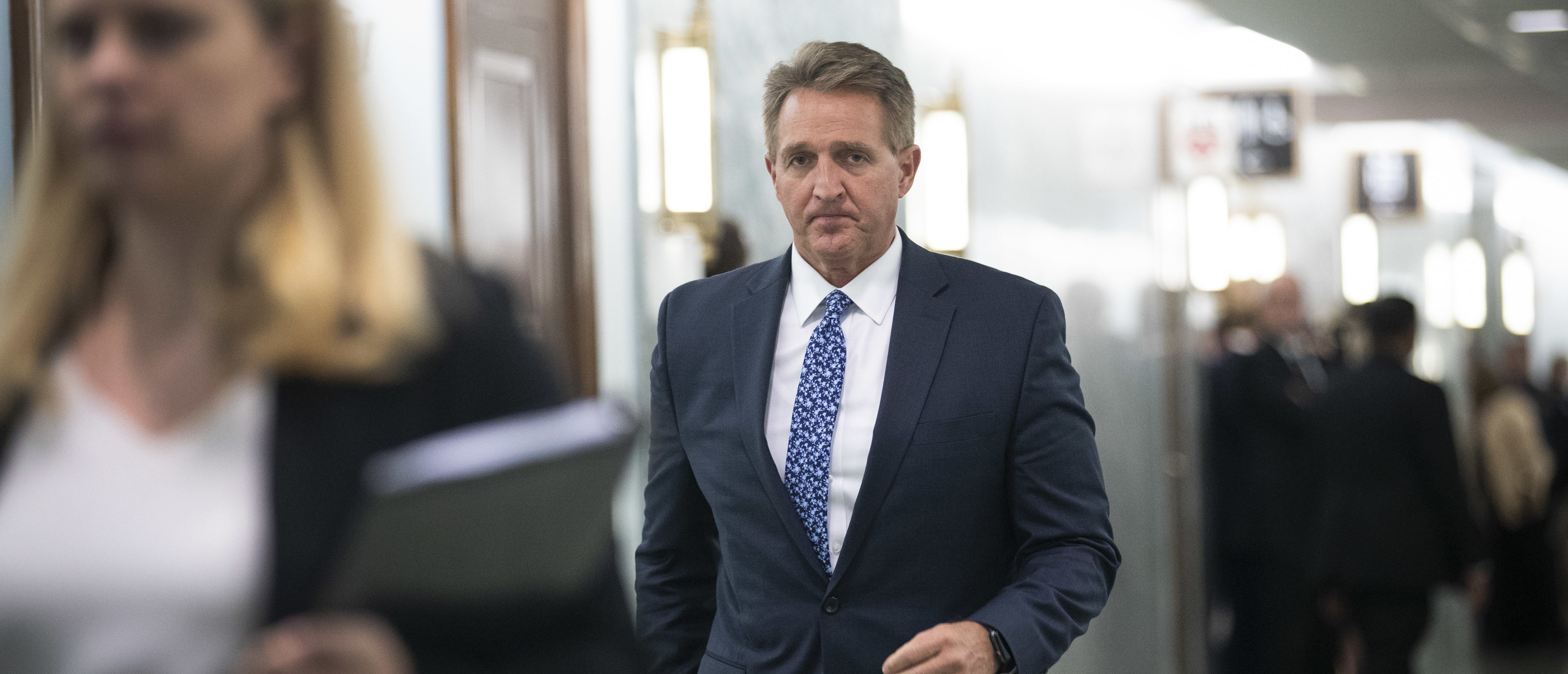 Sen. Jeff Flake (R-AZ) arrives back at the Senate Judiciary Committee hearing following a break, in the Dirksen Senate Office Building on Capitol Hill, September 27, 2018 in Washington, D.C. (Photo by Drew Angerer/Getty Images)