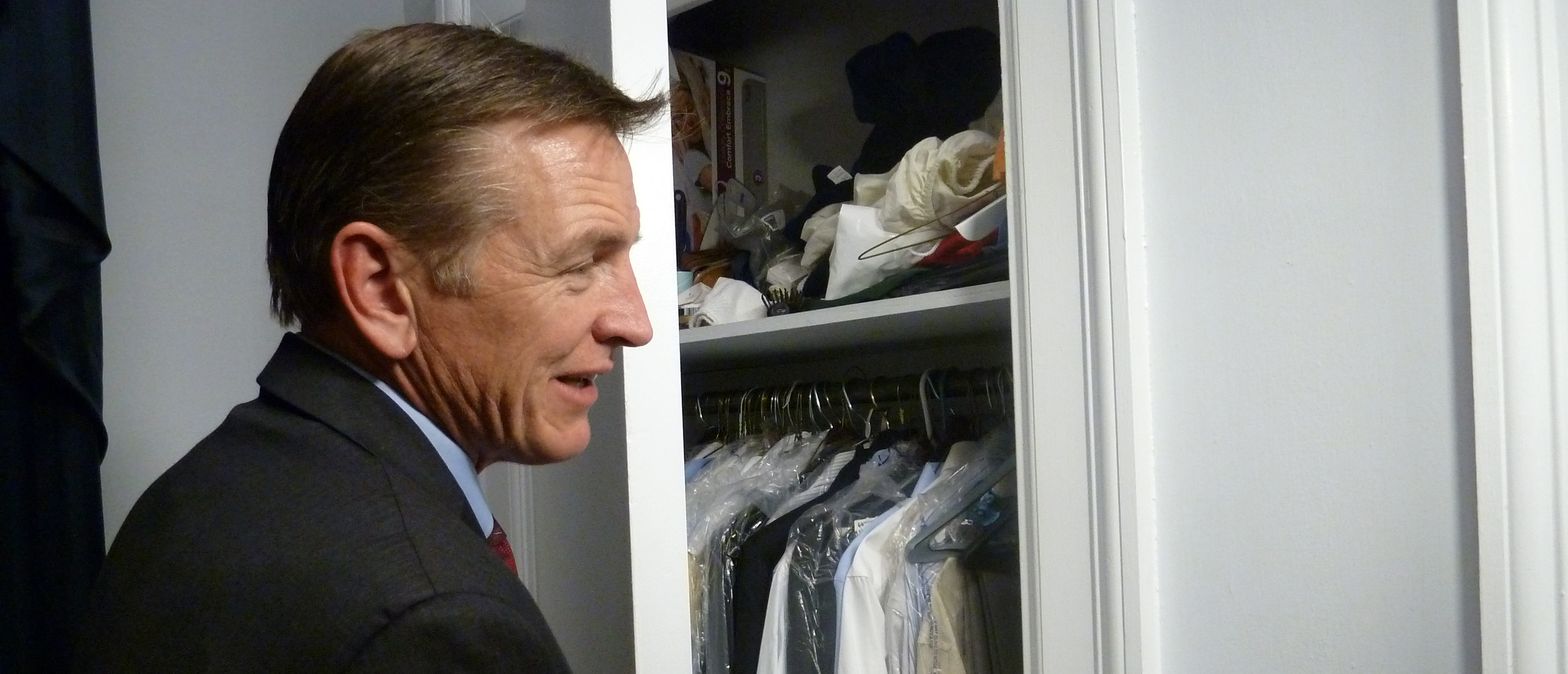 """US Congressman Paul Gosar, Republican of Arizona, opens his closet on December 12, 2012, at the Cannon House Office Building. """"Campers Capitol"""" is a group of 50, mostly men and Republican US lawmakers that work and live in their offices. They are heirs to a tradition that was established in the mid 90s with the blessing of Newt Gingrich, then president of the House of Representatives. """"Waking up every morning in the office helps me remember that my home is not here but there, in my constituency,"""" says Walberg. AFP PHOTO/Raphaelle Picard"""