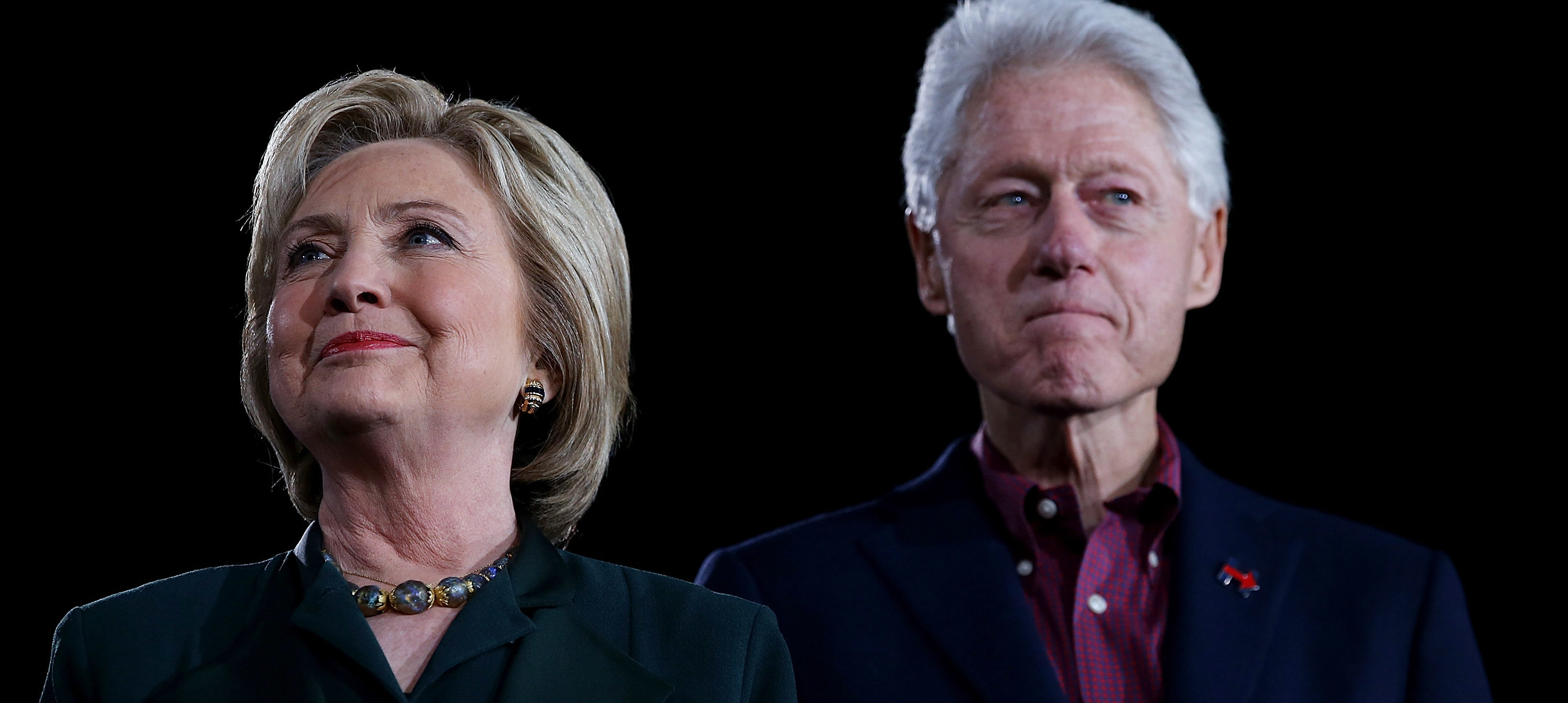"Democratic presidential candidate former Secretary of State Hillary Clinton and her husband, former U.S. president Bill Clinton look on during a ""Get Out The Caucus"" at the Clark County Government Center on February 19, 2016 in Las Vegas. (Photo by Justin Sullivan/Getty Images)"